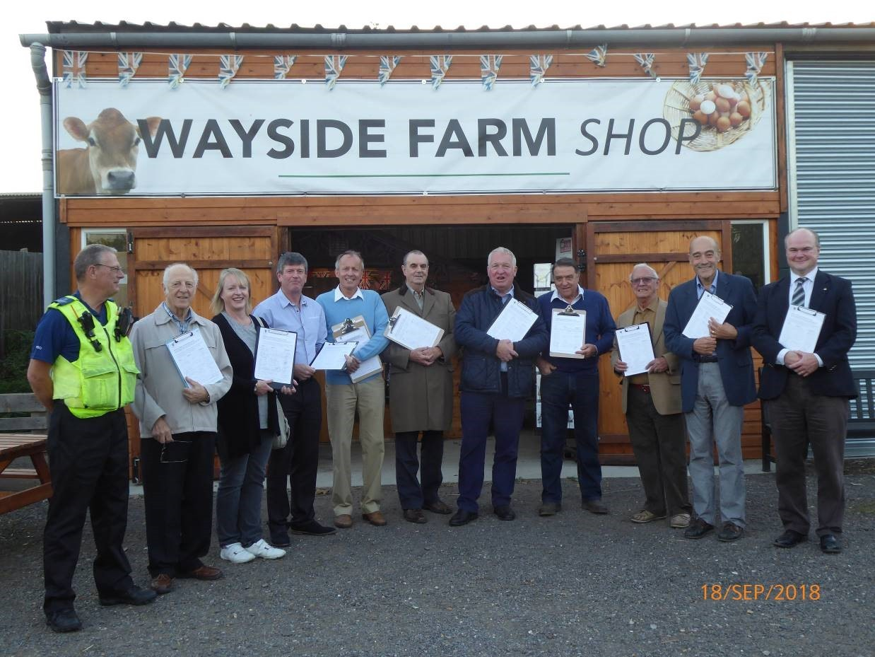 MP Mike Penning received the petition from councillors with Charlie Wray, tenant farmer of Wayside Farm