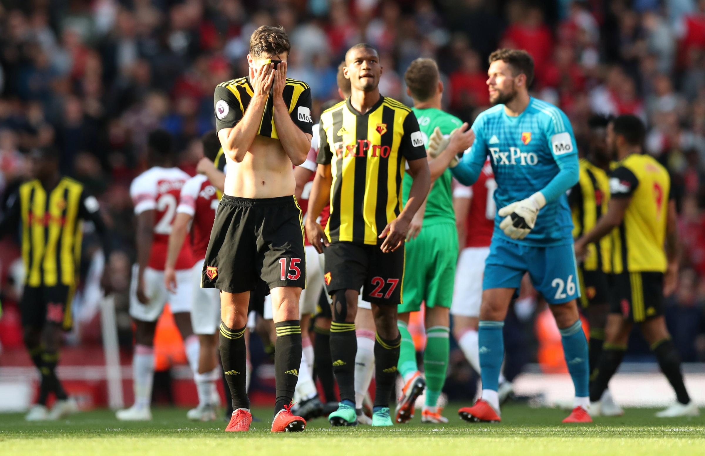 A disappointed Craig Cathcart at full-time after putting through his own net for Arsenal's first goal. Picture: Action Images.