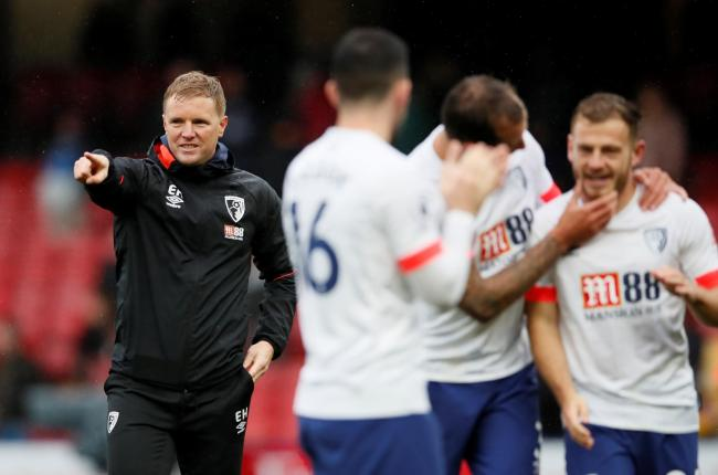 Eddie Howe celebrates with his players after the match. Picture: Action Images