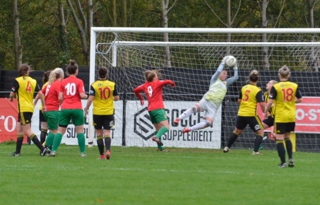 Weronika Baranowska makes a flying save for the Golden Girls. Picture: Len Kerswill
