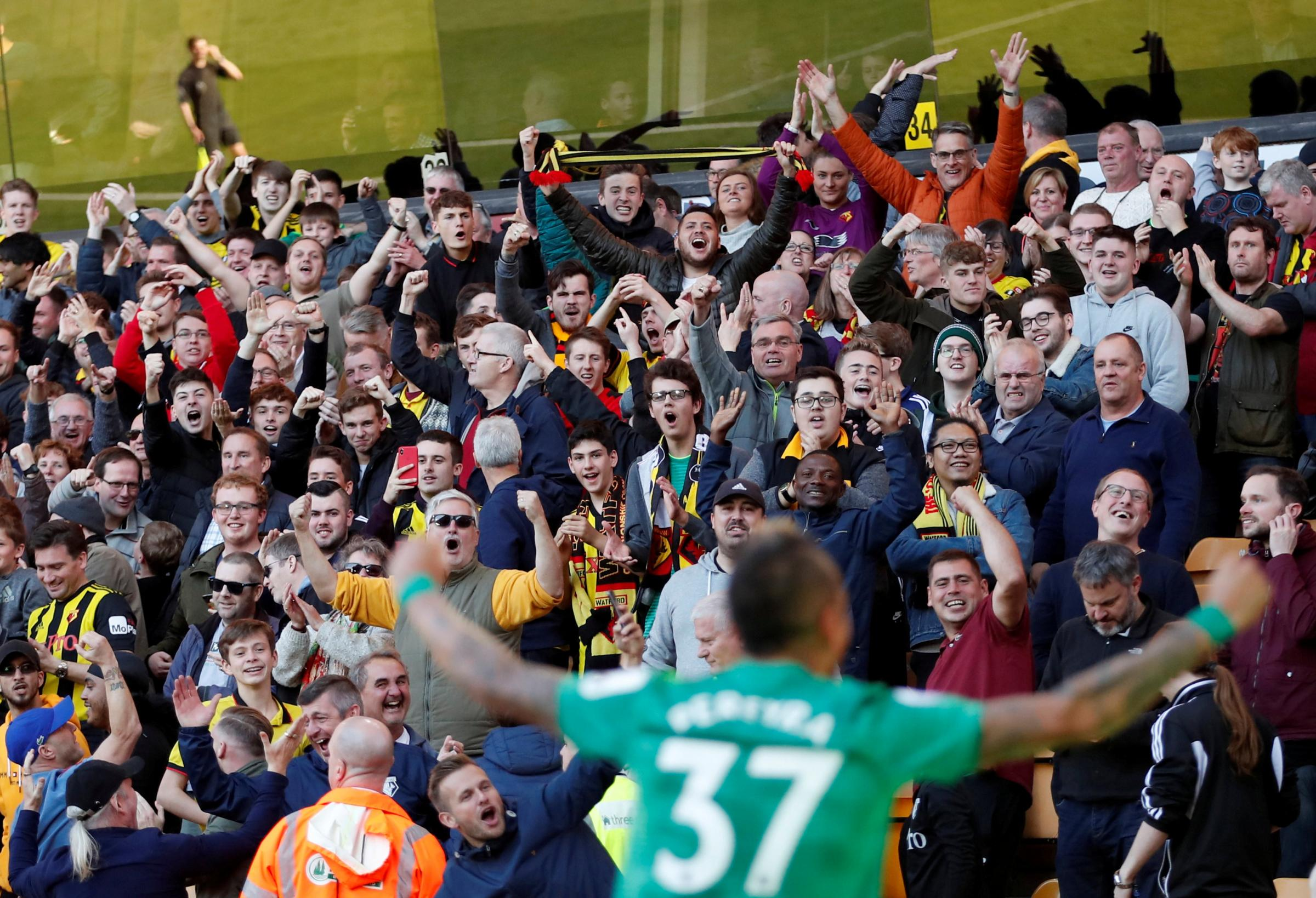 Roberto Pereyra celebrates in front of the jubilant Hornets fans. Pictures: Action Images