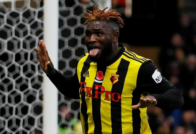 Victory secured: Isaac Success celebrates netting Watford's third goal. Picture: Action Images