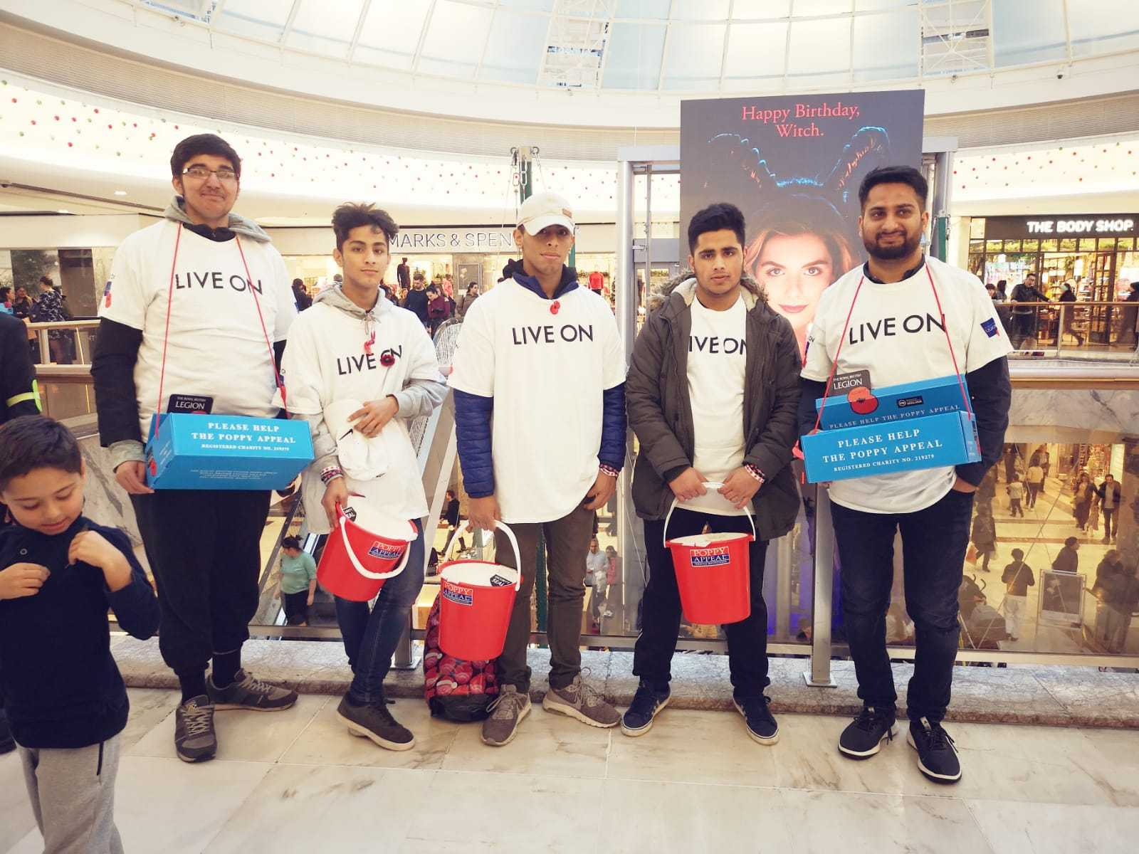 Members of a youth association have been selling poppies
