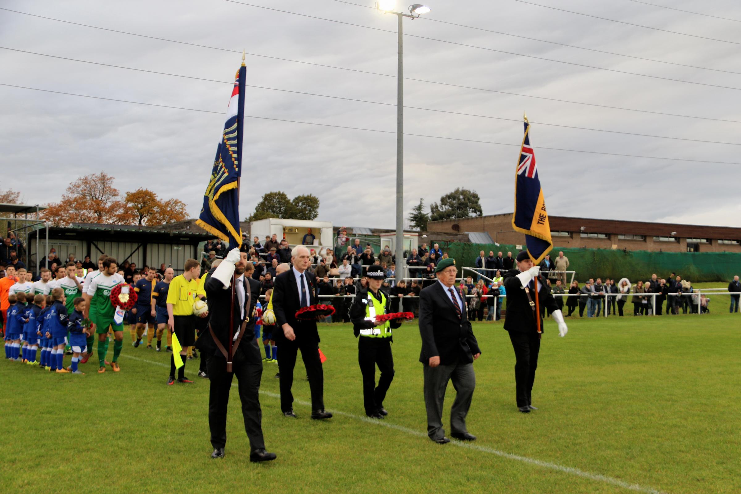 Former Royal Marine Commando and long-time friend of Oxhey Jets Fred Weaving leads the dignataries and teams out for last year's game against 'the Tigers'. He will again be taking the salute for the fallen at tomorrow's match. Picture: Len Kerswill