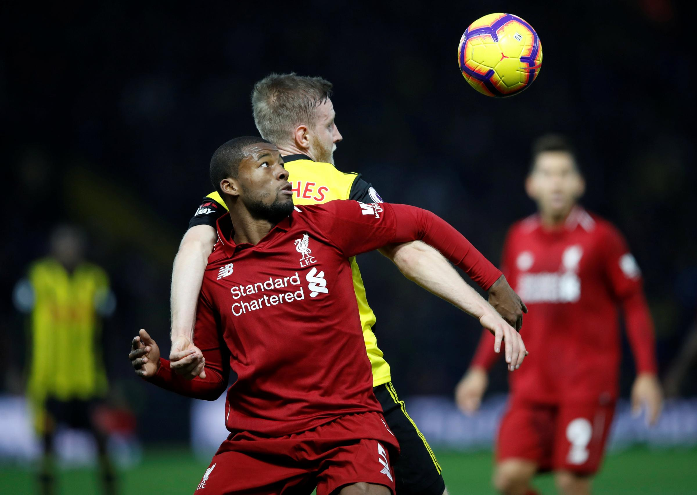 Back-to-back: Will Hughes challenges Georginio Wijnaldum on Saturday. Picture: Action Images