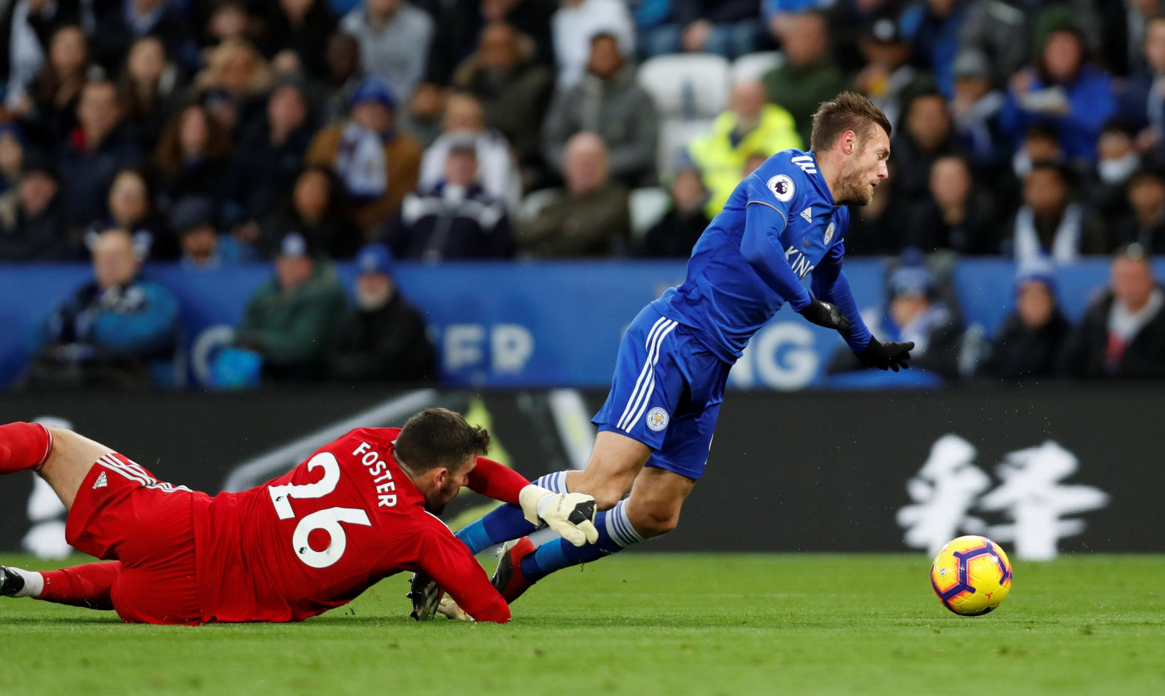 Ben Foster brings down Jamie Vardy at the King Power Stadium. Picture: Action Images
