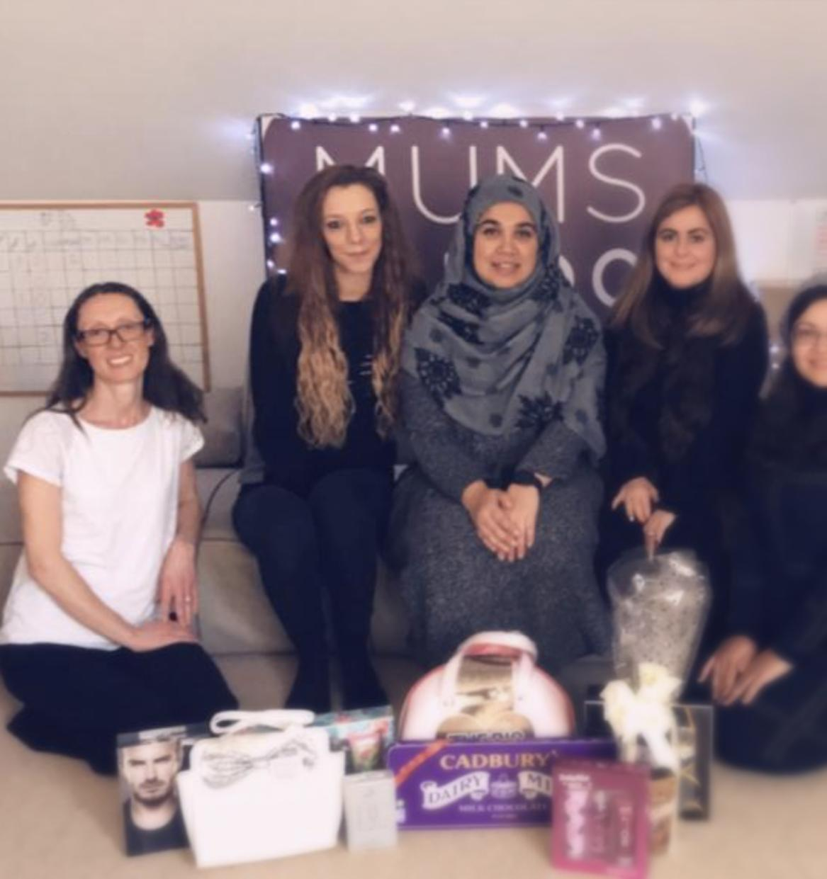 The staff at Mums Can Do are raising money for the Women's Refuge Centre