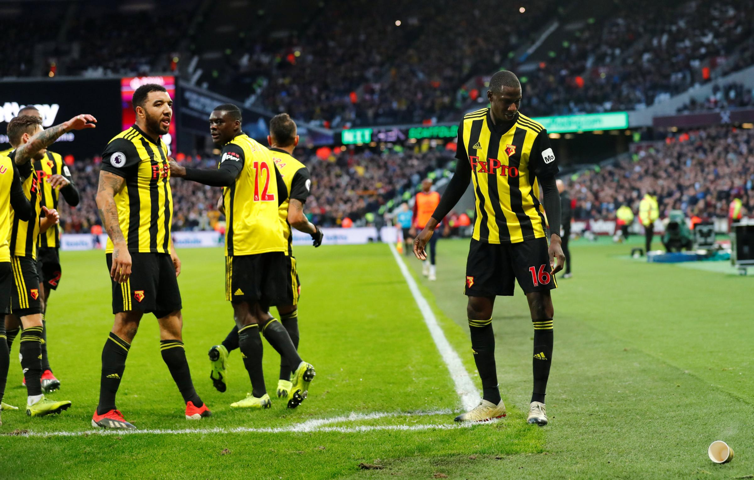 A paper cup was thrown at Troy Deeney during his goal celebration. Picture: Action Images