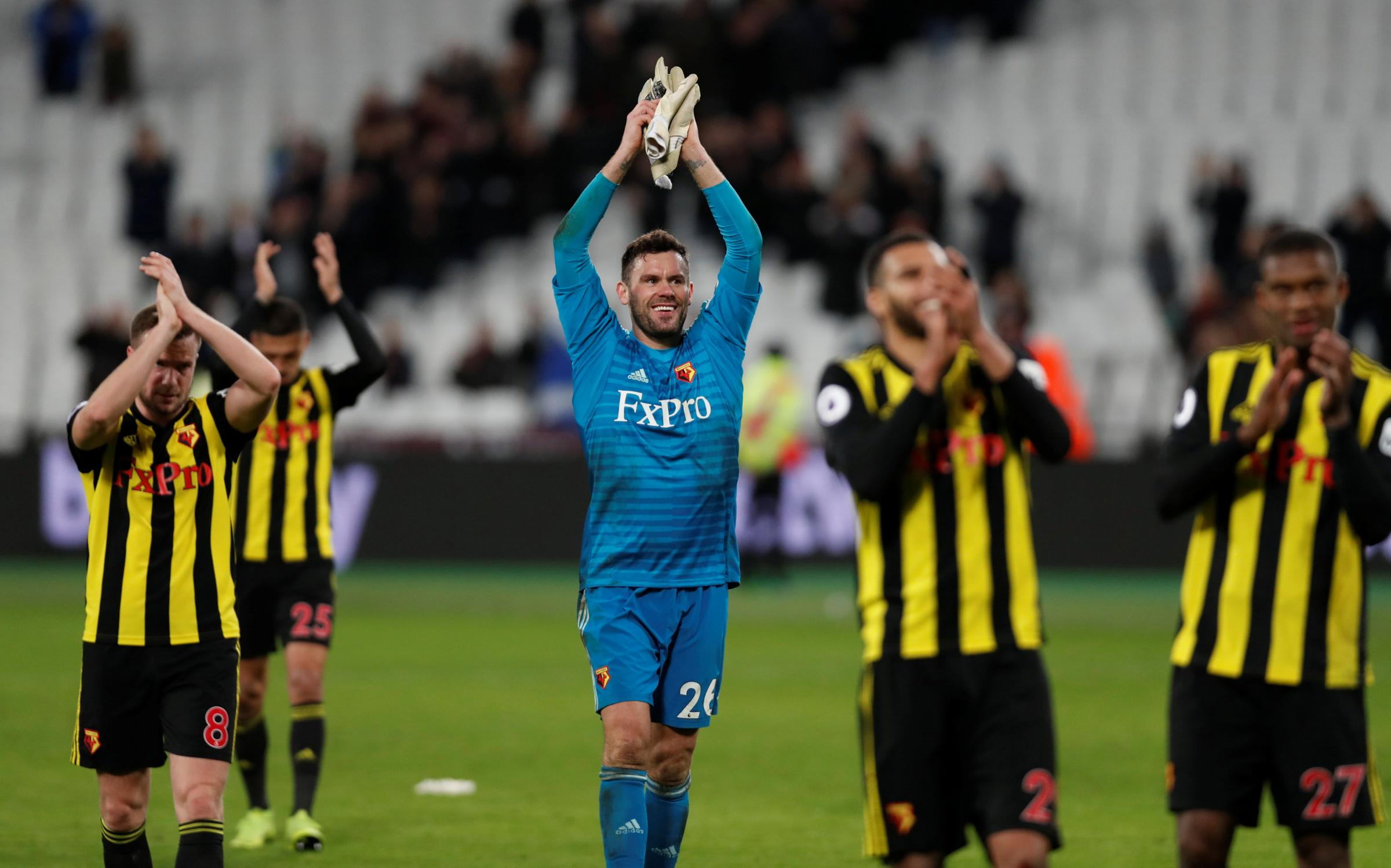 Triumphant: Ben Foster and his teammates applaud the Hornets fans at full-time. Pictures: Action Images