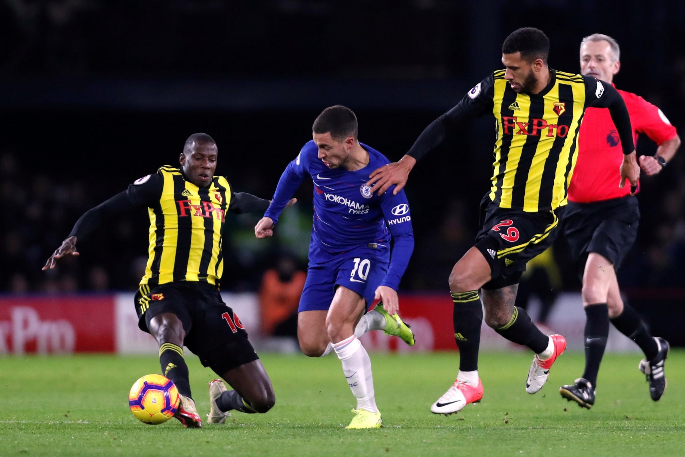 Abdoulaye Doucoure and Etienne Capoue challenge Eden Hazard in last night's defeat at Vicarage Road. Picture: Action Images