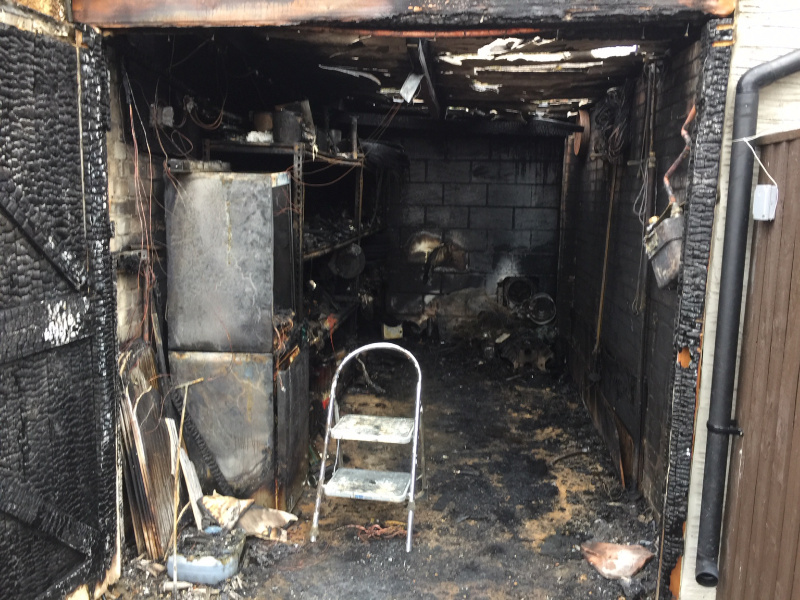 The burnt-out garage at the address where a cannabis farm was found