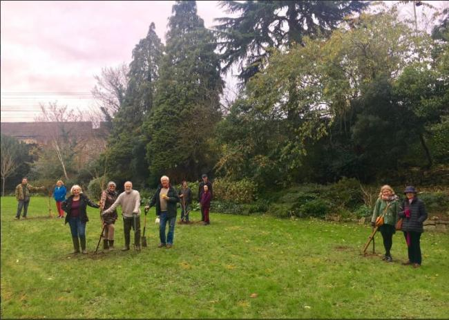 Members of Friends of Oxhey Park pictured on December 8 planting four new trees in memory of Keith Alexander