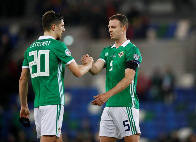 Craig Cathcart celebrates with Jonny Evans at full-time. Picture: Action Images