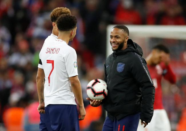 Jadon Sancho celebrates England's victory with Raheem Sterling on Friday night. Picture: Action Images