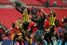 The jubliant Hornets celebrate a dramatic triumph. Picture: Action Images