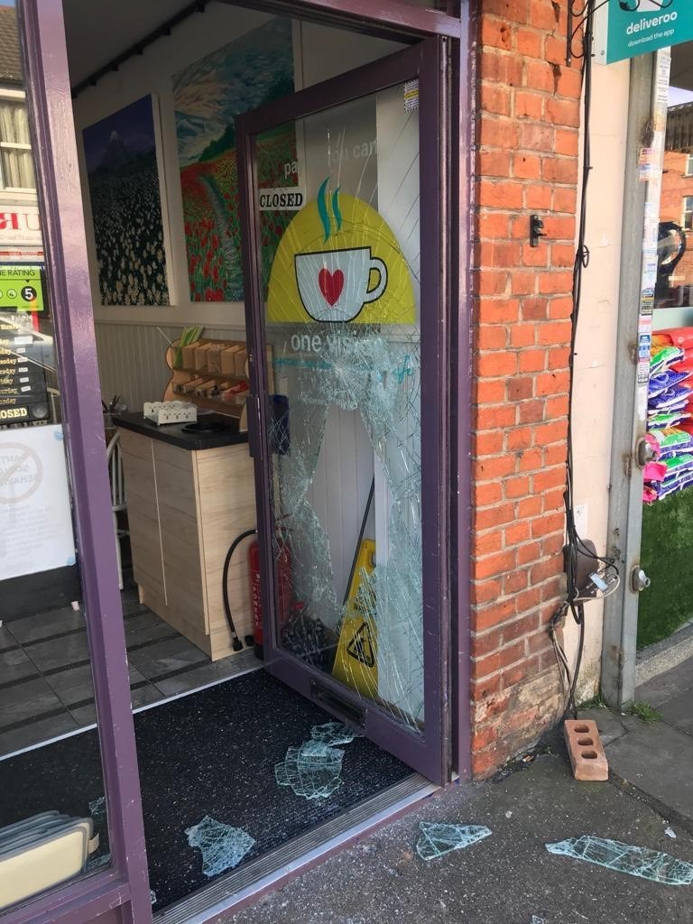 The One Vision cafe's door after the break in