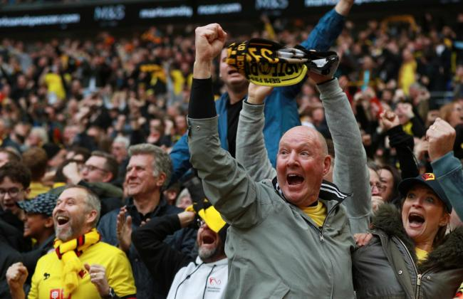 Witnessing history being made: Watford fans celebrating at Wembley on Sunday. Picture: Action Images