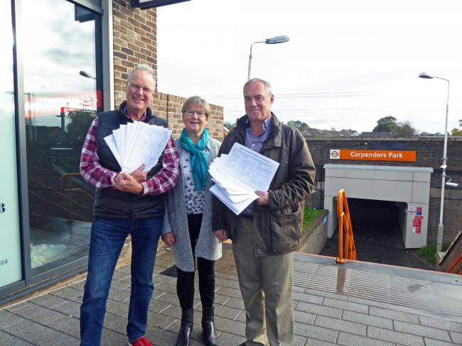left to right: Lib Dem councillors Andrew Scarth, Alison Scarth, and Keith Martin, who have all been involved in the campaign, outside Carpenders Park station