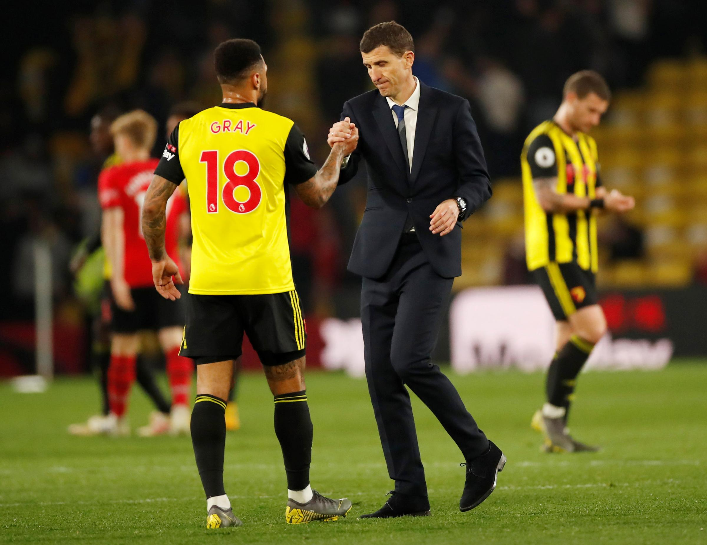 Javi Gracia congratulates Andre Gray after his late equaliser. Picture: Action Images