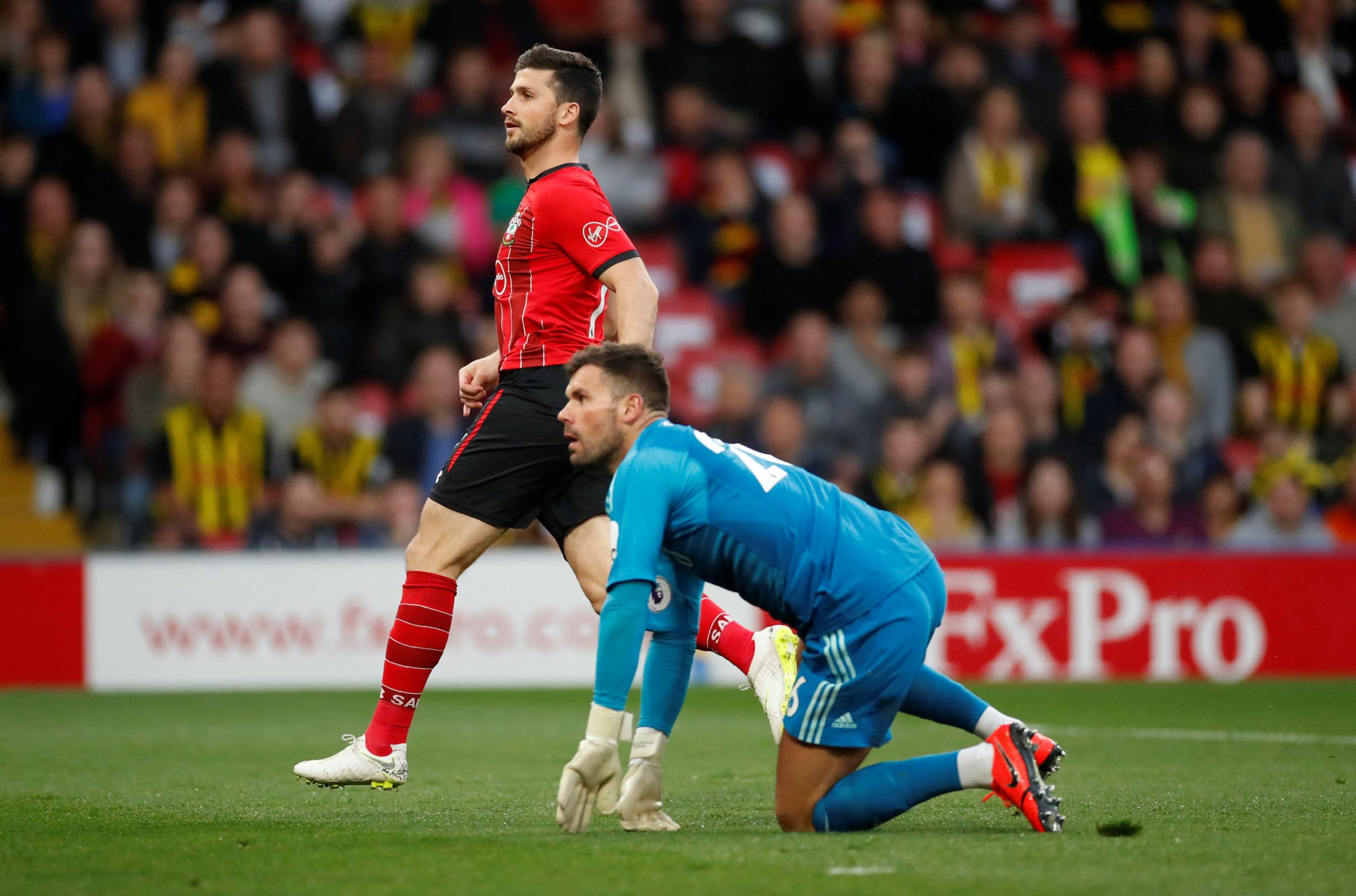Shane Long (in red) scored the fastest goal in Premier League history at Vicarage Road last night. Credit: Action Images
