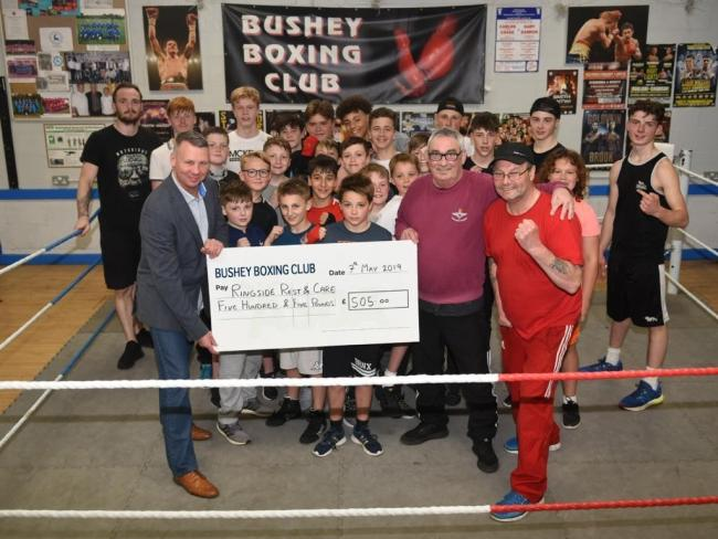 Pictured are members of Bushey Boxing Club. Front left it Bob Williams, in the maroon is Michael Shinkwin, and to his right is fellow coach John Smith