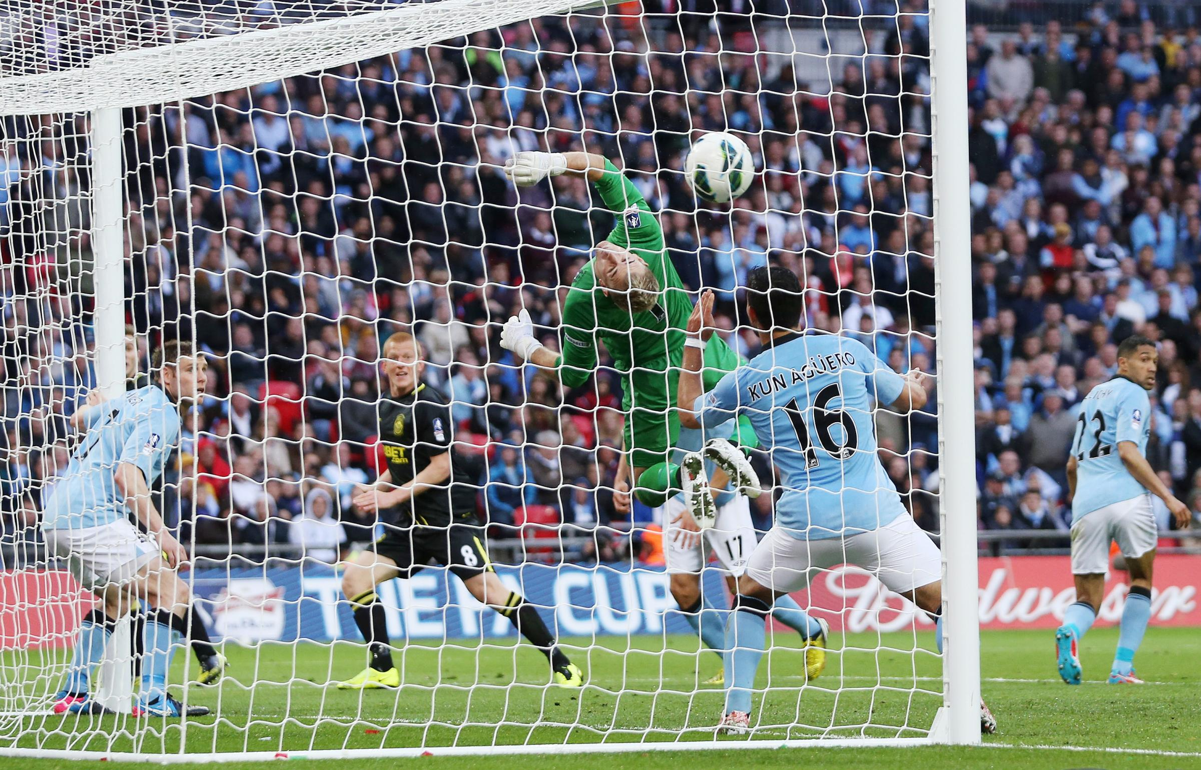 Ben Watson scores against Manchester City in the 2013 FA Cup final. Picture: Action Images