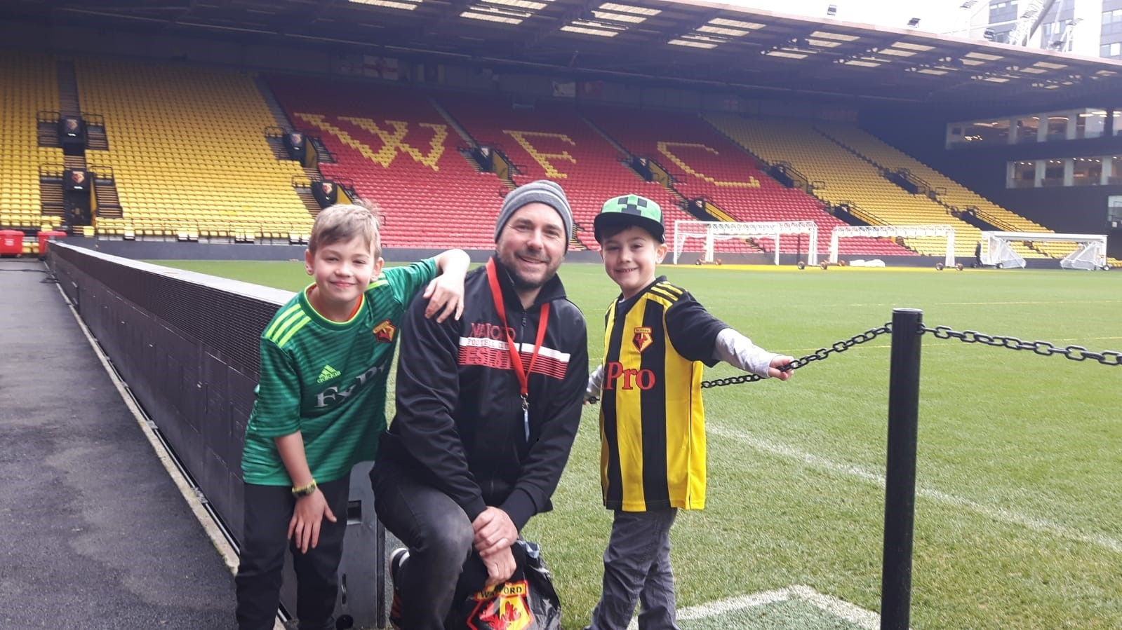Matt Cootes pictured with his boys Harry (left) and Archie (right) at Vicarage Road