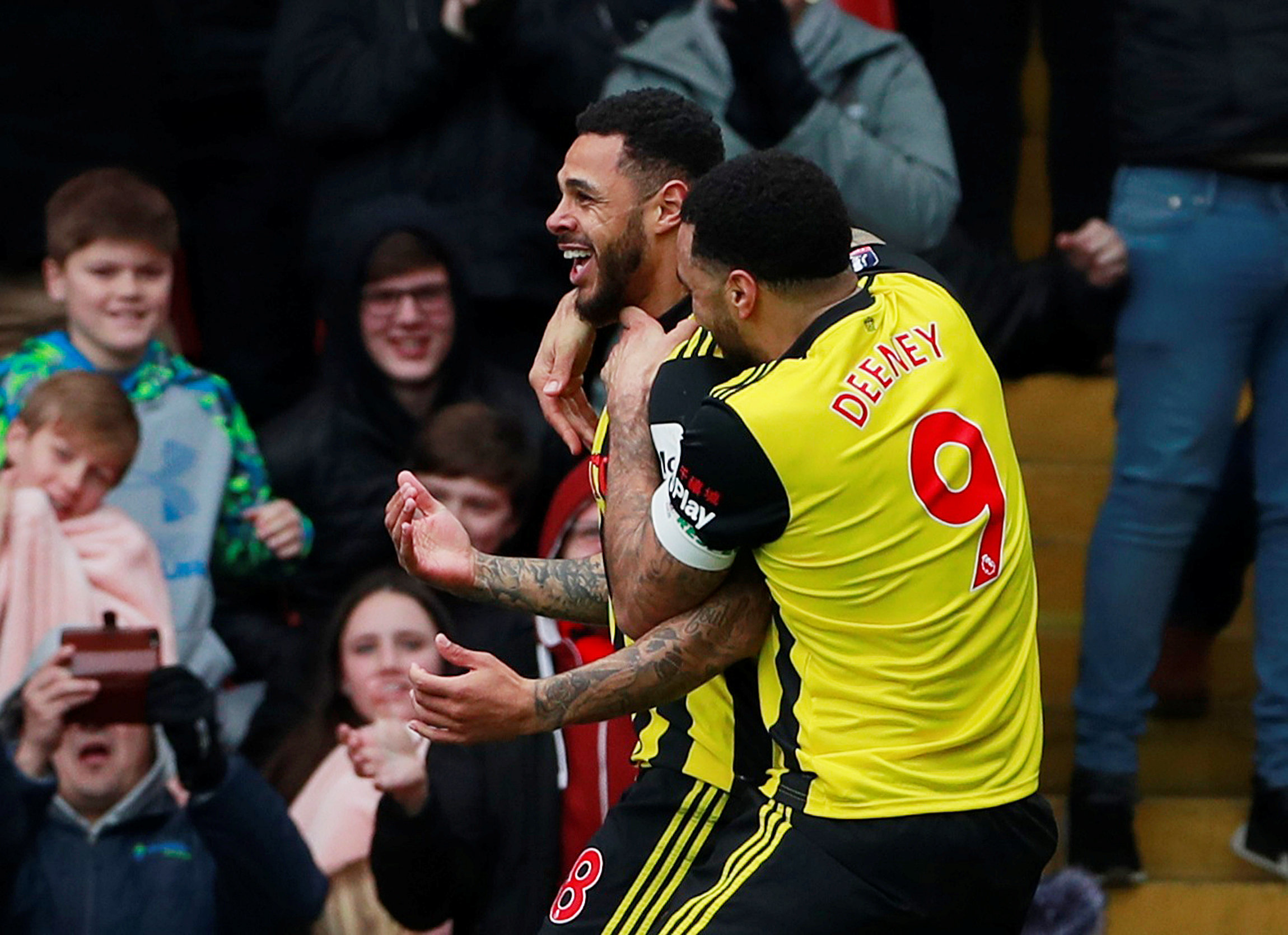 Andre Gray and Deeney celebrate Watford's winner. Picture: Action Images