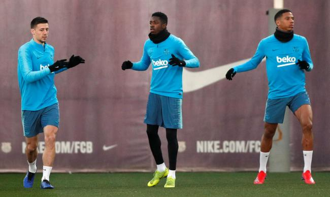 Jean Clair Todibo (right) warms up with Barcelona team-mates Clement Lenglet (left) and Ousamane Dembele (centre). Picture: Action Images
