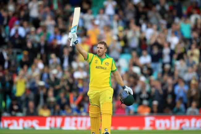 Aaron Finch celebrates reaching his century