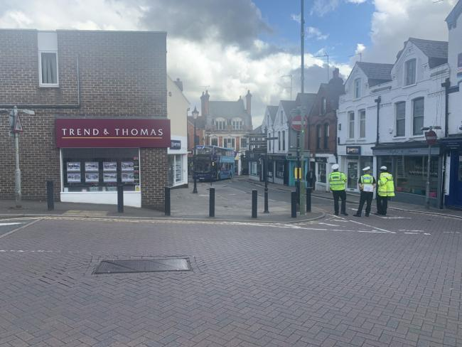 Police in Station Road this afternoon. The bus involved is in the background