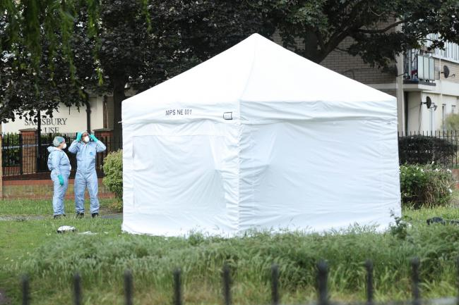 A forensic tent at the scene in Tower Hamlets, East London (Yui Mok/PA)